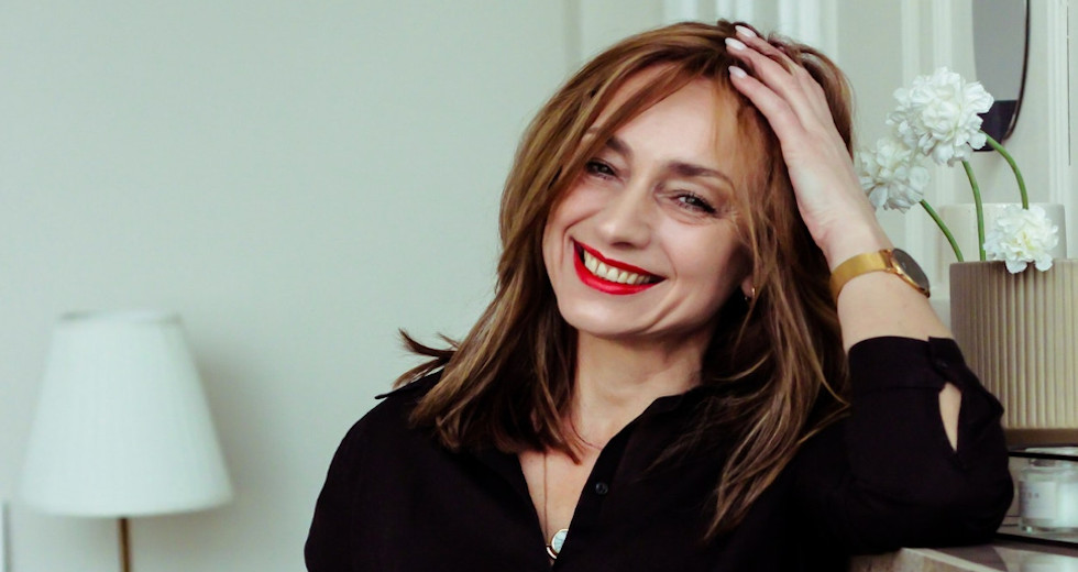 Image of a smiling woman wearing red lipstick