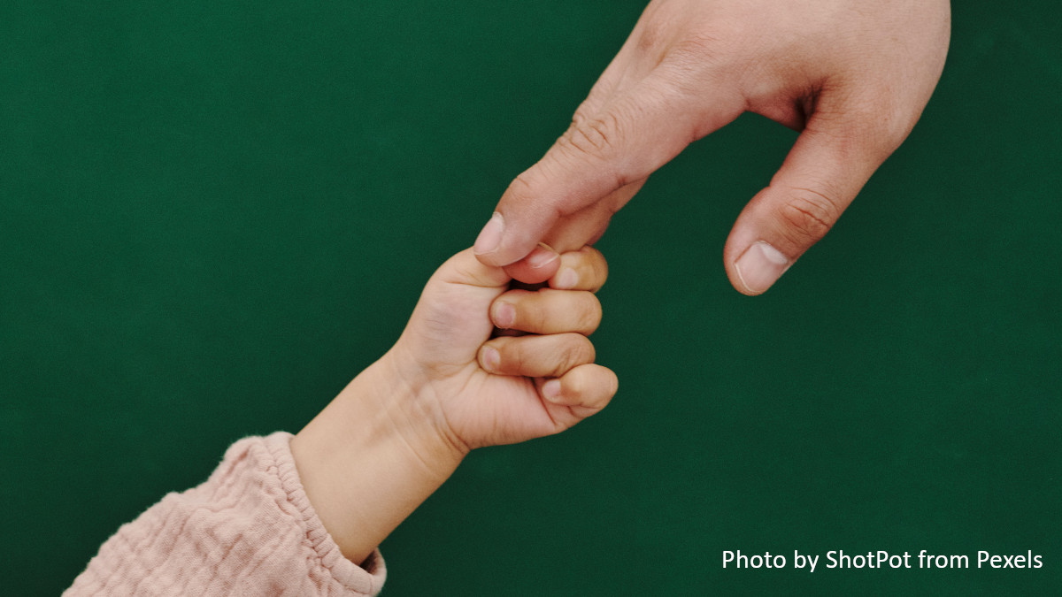 an image of holding hands