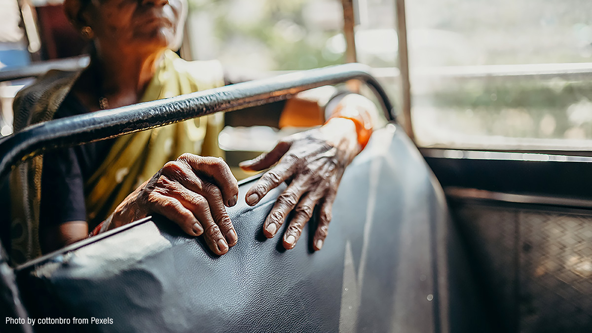 image of old woman sitting on a bus